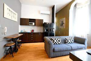 Virtuvė arba virtuvėlė apgyvendinimo įstaigoje Eclectic ApartHotel