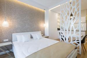 Postel nebo postele na pokoji v ubytování Raj 4 ul. Rajska Stare Miasto