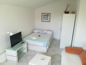 A bed or beds in a room at Olive grove