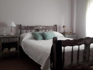 Una cama o camas en una habitación de Hipólito Yrigoyen