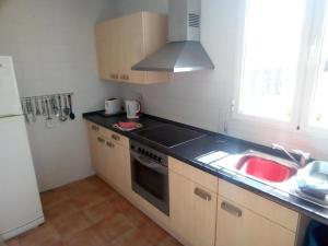 A kitchen or kitchenette at Casa Stevie