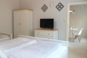 Ein Bett oder Betten in einem Zimmer der Unterkunft Apartments Obdach