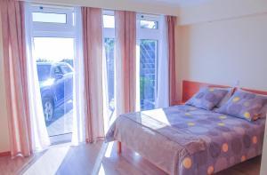 A bed or beds in a room at Prazeres da Vista, Atlantic View In Prazeres, Calheta