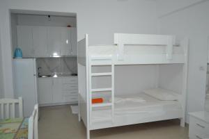 A bunk bed or bunk beds in a room at Vila Renato