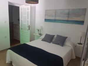 A bed or beds in a room at Casas de Poniente
