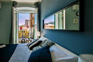 A bed or beds in a room at Alegra Apartments