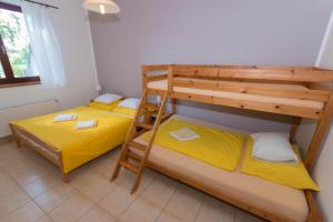 A bunk bed or bunk beds in a room at Pension Terezka