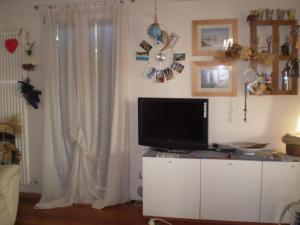 A television and/or entertainment center at Appartamento Ca' Zorzi