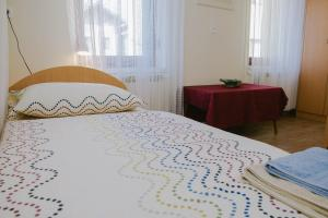 Postelja oz. postelje v sobi nastanitve Apartma Lovriž