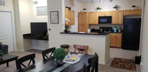 A kitchen or kitchenette at Cane Island Luxury Condo