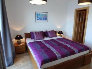 Ein Bett oder Betten in einem Zimmer der Unterkunft THE VIEW ****