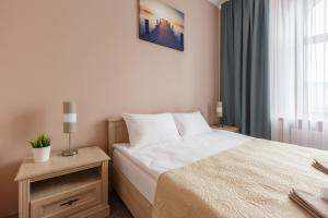 A bed or beds in a room at Nika Apart Hotel