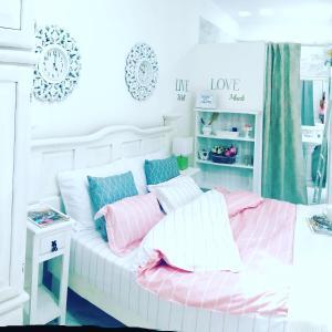 Letto o letti in una camera di Delizioso Monolocale AcasadiAlexPlayadelCarmen