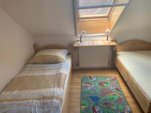 Ein Bett oder Betten in einem Zimmer der Unterkunft Windhör