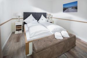 Ein Bett oder Betten in einem Zimmer der Unterkunft Heimathafen Juist