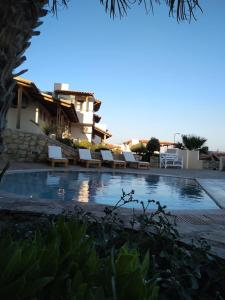 The swimming pool at or near Creta Suites
