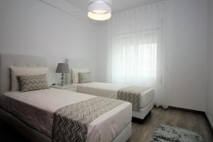 A bed or beds in a room at Apartamentos Gaivota Holidays