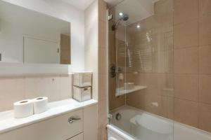 A bathroom at Gorgeous 2BR Flat in London by GuestReady