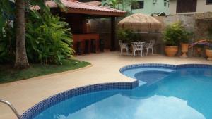 The swimming pool at or near Casa Guarujá Praia do Pernambuco