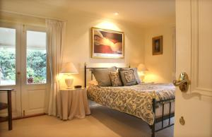 A bed or beds in a room at Midnights Promise Estate