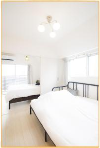 A bed or beds in a room at AMP FLAT Tenjin Minami K