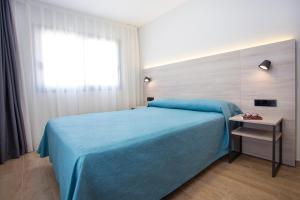 A bed or beds in a room at Apartamentos Maryciel By Mc