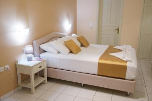 A bed or beds in a room at Studios Vrionis Panoramic Sunset