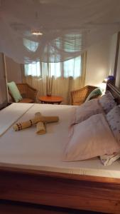 A bed or beds in a room at Casa Carlotta & Villa
