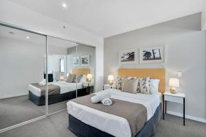 A bed or beds in a room at H-Residences - GCLR
