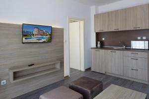 A television and/or entertainment center at Complex Moskoyani