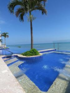 The swimming pool at or near LUXURY 3 MINUTES FROM THE AIRPORT/TOURIST AREA