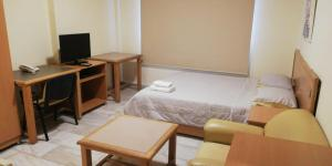 A bed or beds in a room at Minto Suites Furnished Apartments