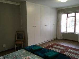 A bed or beds in a room at 18 Patrys Crescent