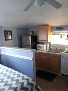 A kitchen or kitchenette at The Cottages at Madeira Beach