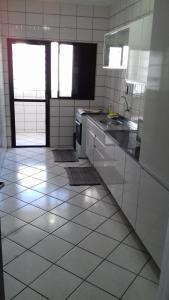 A kitchen or kitchenette at Apartamento Dante Tomio