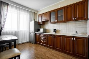 A kitchen or kitchenette at Apart-Hotel Resident
