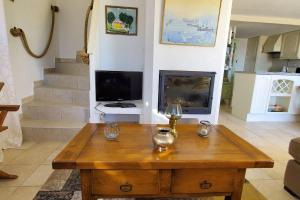 A television and/or entertainment centre at Villa in Theoule with a Gorgeous Sea View