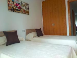 Giường trong phòng chung tại Fantastico Apartamento con solárium