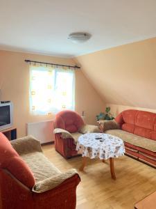 A seating area at Apartments Lalović