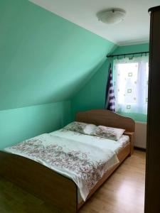 A bed or beds in a room at Apartments Lalović