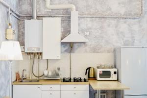Кухня или мини-кухня в Апартаменты Personnage