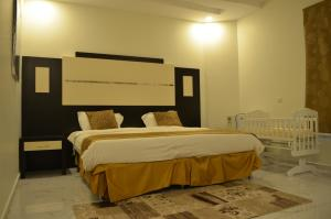 A bed or beds in a room at Alreef Diamond Villas - Families Only