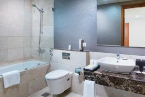 A bathroom at Millennium Executive Apartments Muscat