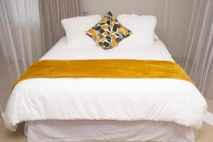 A bed or beds in a room at Dede Apartment -A Home Away From Home...