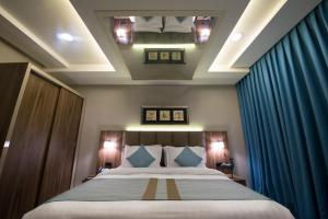 A bed or beds in a room at Bram Suites
