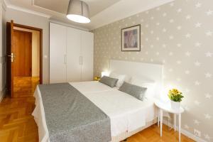 מיטה או מיטות בחדר ב-Dunav Aparthotel Residence