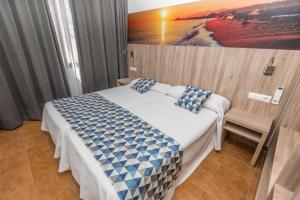 A bed or beds in a room at Apartments Niko