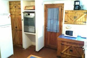 A kitchen or kitchenette at Pourquoi Pas?