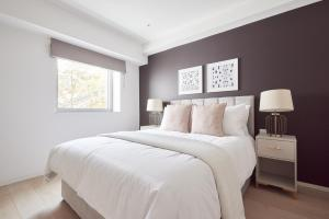 A bed or beds in a room at Sonder — Oxford Circus