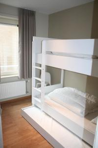 Ein Etagenbett oder Etagenbetten in einem Zimmer der Unterkunft Xanadu